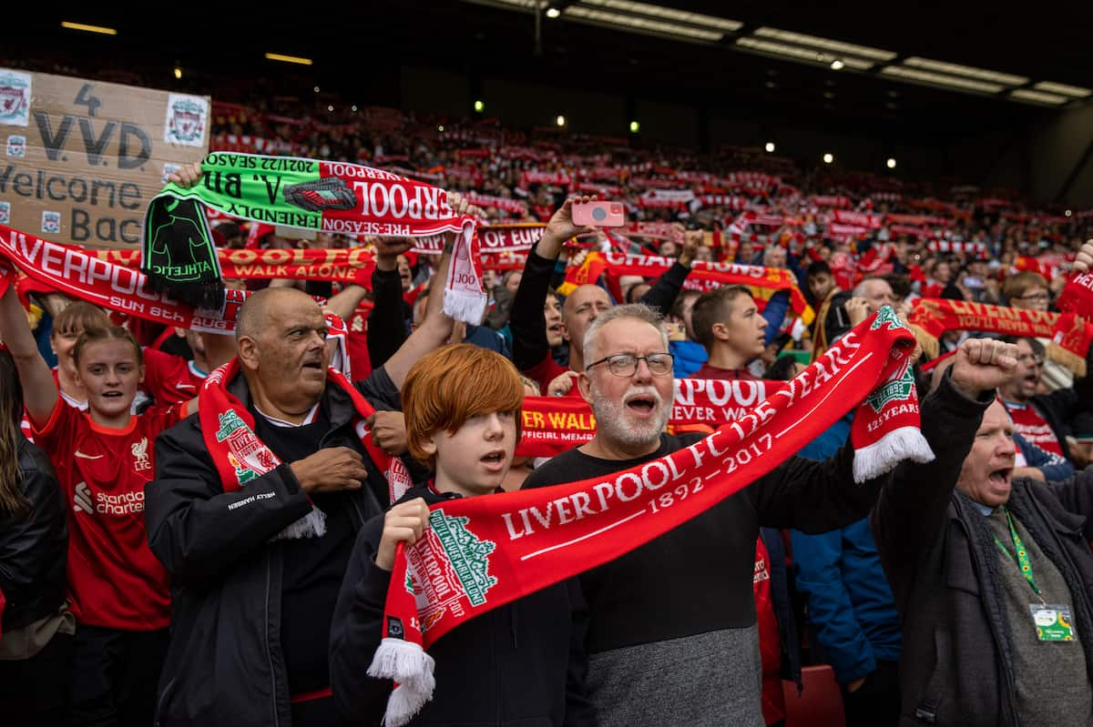 """LIVERPOOL, ENGLAND - Sunday, August 8, 2021: Liverpool supporters on the Spion Kop hold up scarves and sing """"You'll Never Walk Alone"""" before a pre-season friendly match between Liverpool FC and Athletic Club de Bilbao at Anfield. The game ended in a 1-1 draw. (Pic by David Rawcliffe/Propaganda)"""