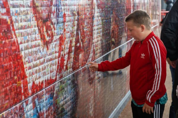 LIVERPOOL, ENGLAND - Saturday, August 21, 2021: Liverpool supporters look at photographs on the Champions Wall before the FA Premier League match between Liverpool FC and Burnley FC at Anfield. Liverpool won 2-0. (Pic by David Rawcliffe/Propaganda)