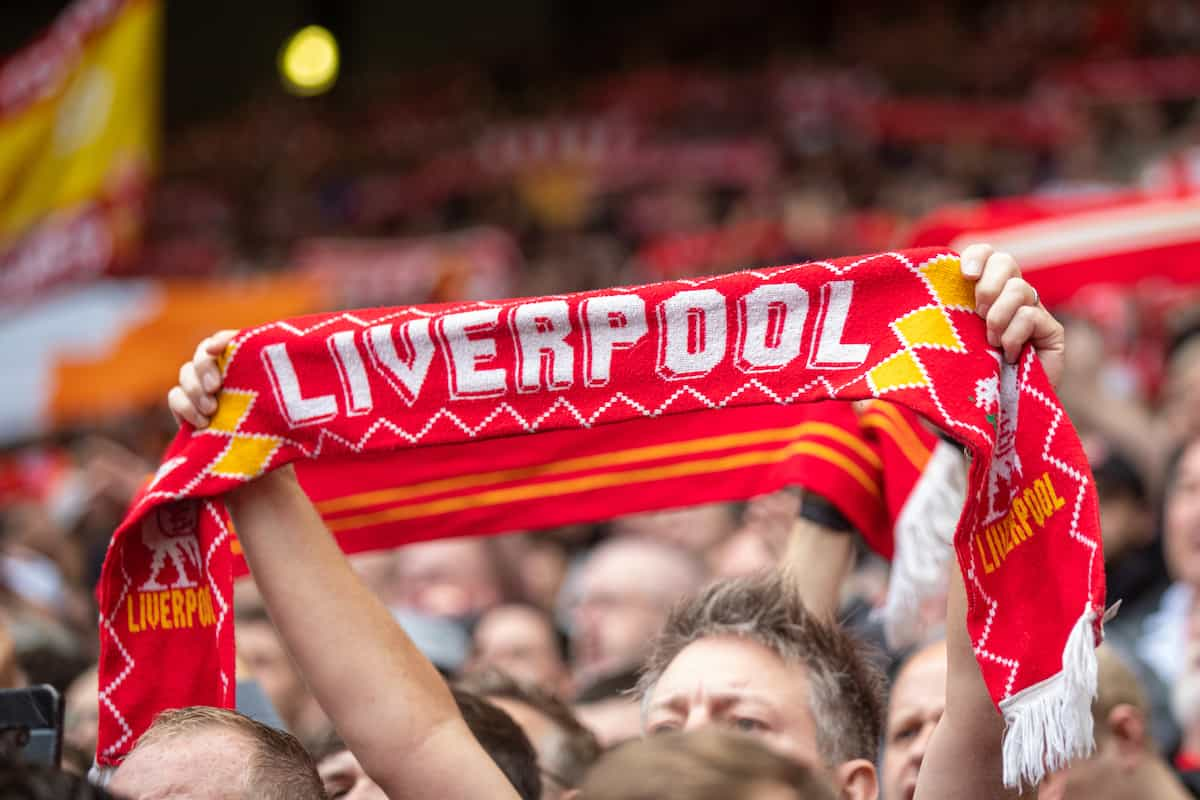 """LIVERPOOL, ENGLAND - Saturday, August 21, 2021: Liverpool supporters on the Spion Kop sing """"You'll Never Walk Alone"""" before the FA Premier League match between Liverpool FC and Burnley FC at Anfield. Liverpool won 2-0. (Pic by David Rawcliffe/Propaganda)"""