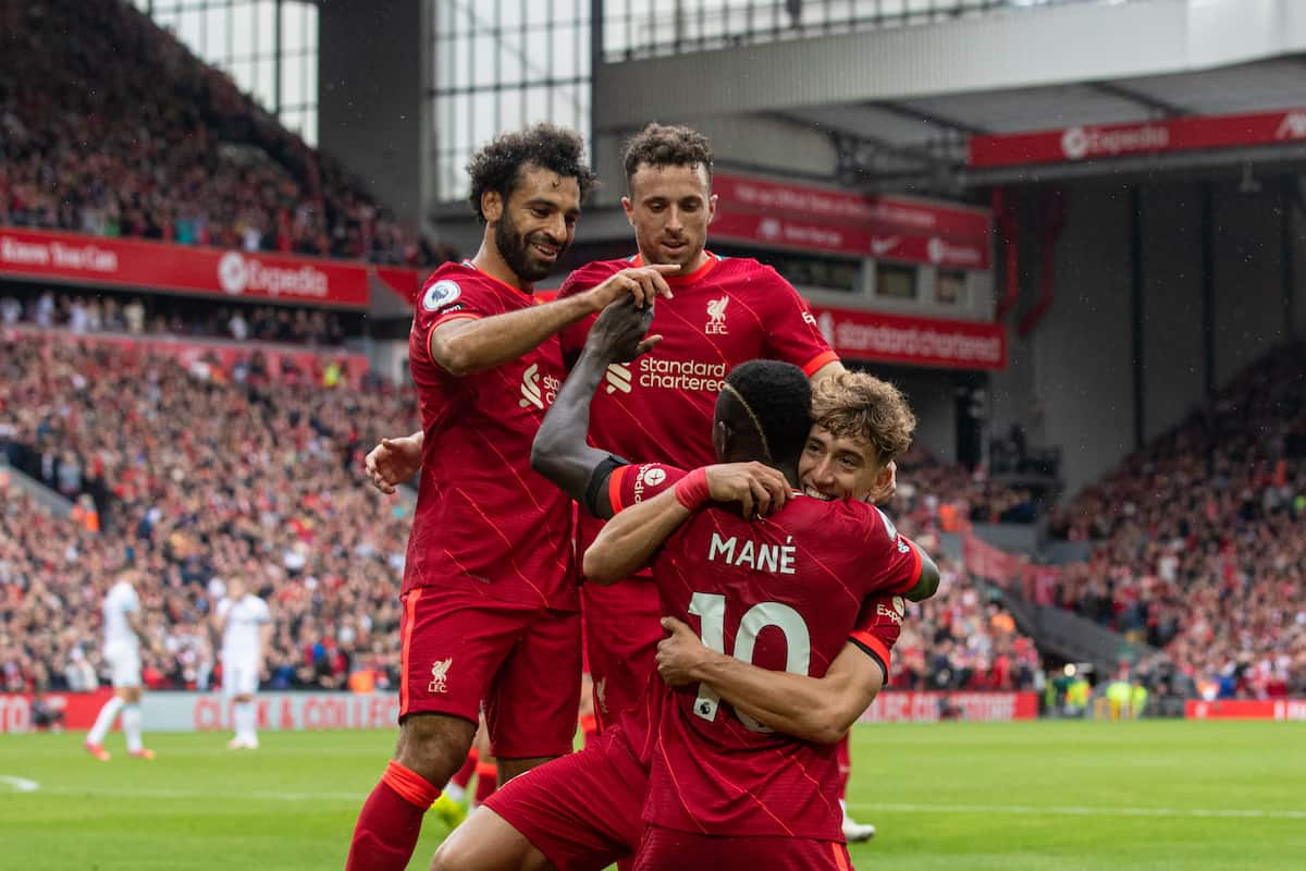 LIVERPOOL, ENGLAND - Saturday, August 21, 2021: Liverpool's Sadio Mané (#10) celebrates with team-mates Mohamed Salah (L), Diogo Jota (C) and Kostas Tsimikas (R) after scoring the second goal during the FA Premier League match between Liverpool FC and Burnley FC at Anfield. Liverpool won 2-0. (Pic by David Rawcliffe/Propaganda)