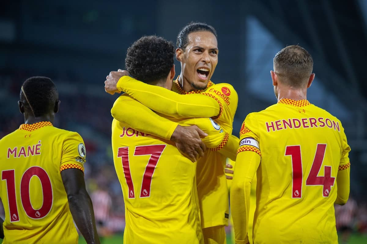 LONDON, ENGLAND - Saturday, September 25, 2021: Liverpool's Curtis Jones (L) celebrates with team-mate Virgil van Dijk after scoring the third goal during the FA Premier League match between Brentford FC and Liverpool FC at the Brentford Community Stadium. (Pic by David Rawcliffe/Propaganda)