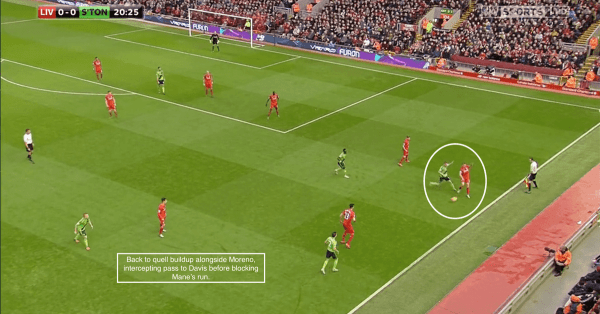 Back to quell buildup alongside Moreno, intercepting pass to Davis before blocking Mane's run.