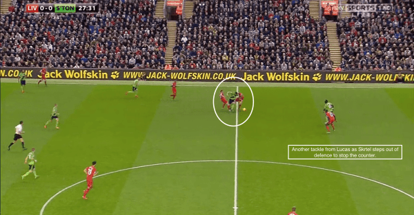Another tackle from Lucas as Skrtle steps out of defence to stop the counter.