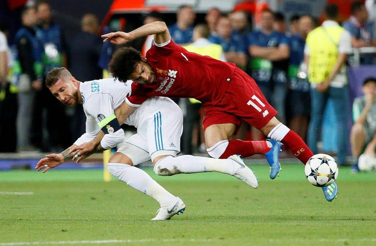 2CPD2PP Soccer Football - Champions League Final - Real Madrid v Liverpool - NSC Olympic Stadium, Kiev, Ukraine - May 26, 2018 Liverpool's Mohamed Salah injures his shoulder in a challenge with Real Madrid's Sergio Ramos REUTERS/Gleb Garanich