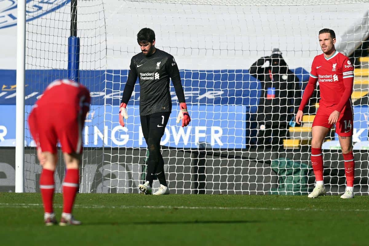 2EC6AFE Liverpool goalkeeper Alisson (centre) stands dejected after conceding the third Leicester goal during the Premier League match at the King Power Stadium, Leicester. Picture date: Saturday February 13, 2021. (PA Images / Alamy Stock Photo)