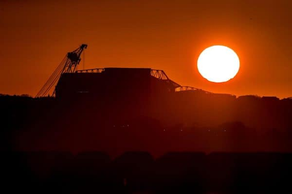 The sun rises behind Anfield stadium in Liverpool. Picture date: Friday February 26, 2021.