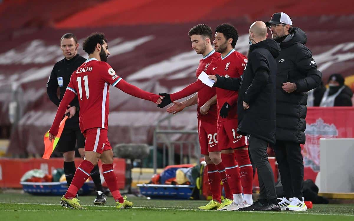 2EXGCTP Liverpool's Mohamed Salah (left) leaves the game as team-mates Diogo Jota (centre) and Alex Oxlade-Chamberlain come on during the Premier League match at Anfield, Liverpool. Picture date: Thursday March 4, 2021.