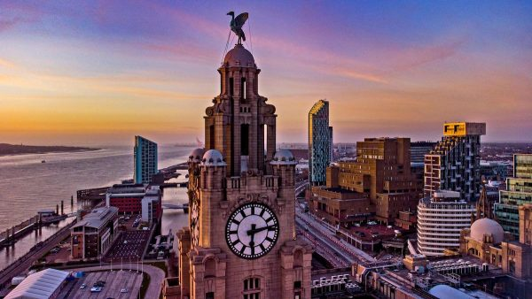 The sun sets behind the Royal Liver Building in Liverpool. Picture date: Wednesday March 17, 2021. (Photo: Peter Byrne / PA Images / Alamy)