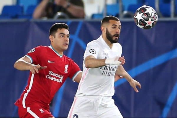 Liverpool's Ozan Kabak (left) and Real Madrid's Karim Benzema battle for the ball during the UEFA Champions League match at the Alfredo Di Stefano Stadium, Madrid. Picture date: Tuesday April 6, 2021.