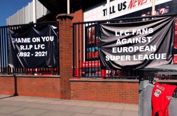 A Liverpool branded hoodie is placed in a bin and banners are placed outside of Anfield, home of Liverpool FC to protest against its decision to be included amongst the clubs attempting to form a new European Super League. Issue date: Monday April 19, 202