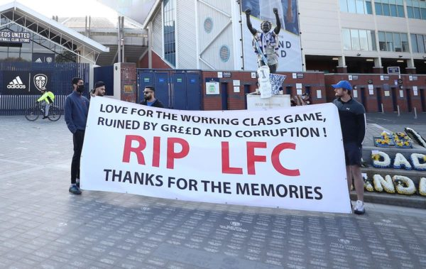 Banners outside the stadium against Liverpool's decision to be included amongst the clubs attempting to form a new European Super League before the Premier League match at Elland Road, Leeds. Picture date: Monday April 19, 2021.
