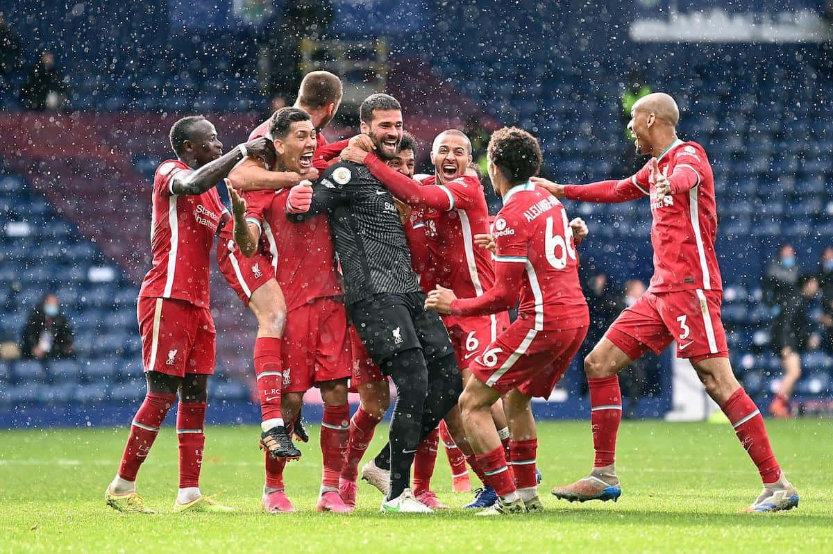 2FND1T6 Liverpool goalkeeper Alisson celebrates scoring their side's second goal of the game with team-mates during the Premier League match at The Hawthorns, West Bromwich. Picture date: Sunday May 16, 2021.