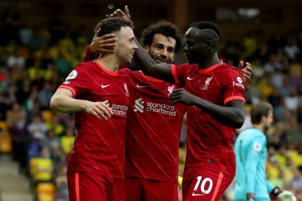 Carrow Road, Norwich, Norfolk, UK. 14th Aug, 2021. Premier League football, Norwich versus Liverpool; Diogo Jota of Liverpool celebrates with Mohamed Salah and Sadio Mane after he scores for 0-1 in the 26th minute Credit: Action Plus Sports/Alamy Live News