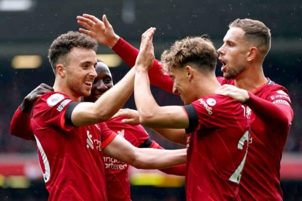 Liverpool's Diogo Jota (left) celebrates with his team-mates after scoring their side's first goal of the game during the Premier League match at Anfield, Liverpool. Picture date: Saturday August 21, 2021. (Mike Egerton / Alamy Photo)