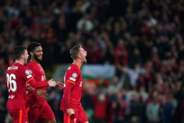 Liverpool's Jordan Henderson (right) celebrates scoring their side's third goal of the game during the UEFA Champions League, Group B match at Anfield, Liverpool. Picture date: Wednesday September 15, 2021.