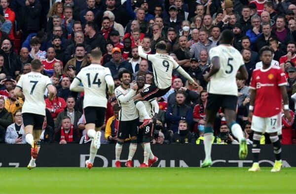 Liverpool's Naby Keita (centre) celebrates scoring their side's first goal of the game with team mates during the Premier League match at Old Trafford, Manchester. Picture date: Sunday October 24, 2021.