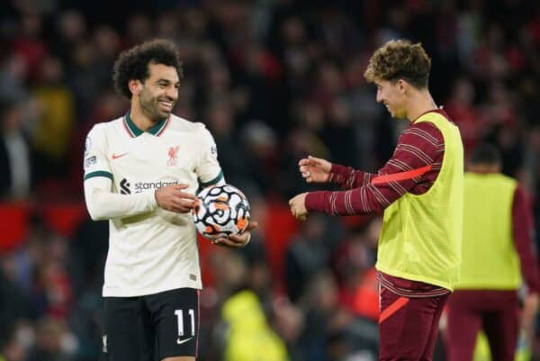 Liverpool hat-trick scorer Mohamed Salah (left) celebrates with the match ball after the final whistle during the Premier League match at Old Trafford, Manchester. Picture date: Sunday October 24, 2021.
