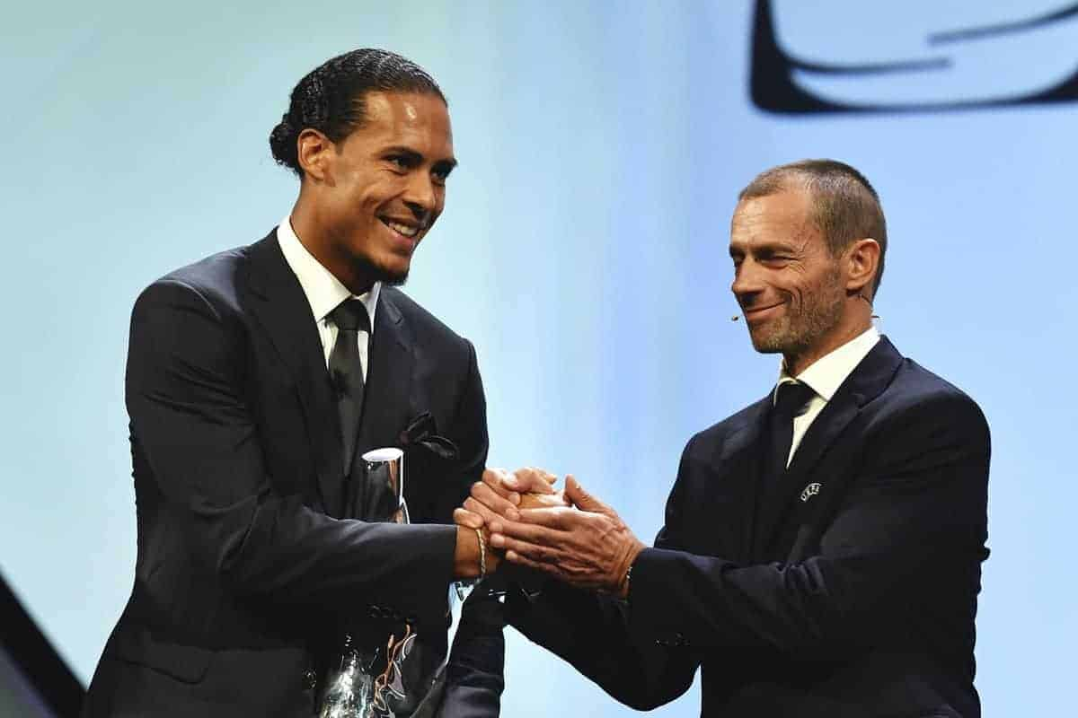 MONACO, MONACO - AUGUST 29: UEFA President, Aleksander eferin presents Virgil van Dijk with the UEFA Men's Player of the Year 2018/19 Award during the UEFA Champions League Draw, part of the UEFA European Club Football Season Kick-Off 2019/2020 at Salle des Princes, Grimaldi Forum on August 29, 2019 in Monaco, Monaco. (Photo by Harold Cunningham - UEFA/UEFA via Getty Images)