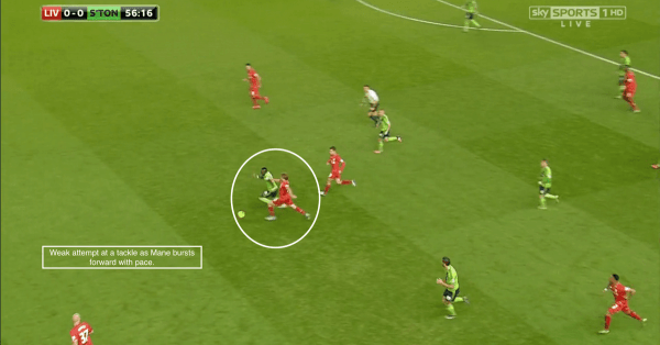Weak attempt at a tackle as Mane bursts forward with pace.