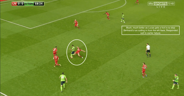 Much, much better as Lucas gets a foot in to stop Bertrand's run cutting in from the left flank. Responded well to earlier failure.