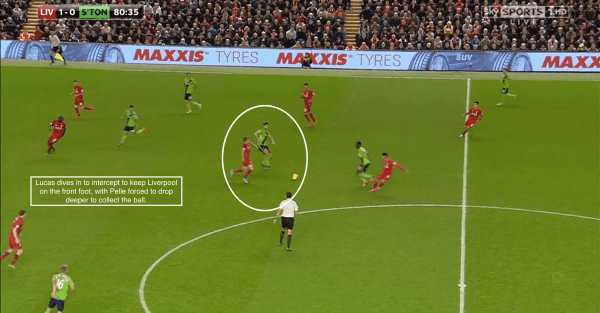 Lucas dives in to intercept to keep Liverpool on the front foot, with Pelle forced to drop deeper to collect the ball.