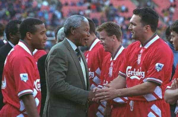 JOHANNESBURG, REPUBLIC OF SOUTH AFRICA - Sunday, May 29, 1994: Life-long Liverpool FC supporter and newly elected President of the Republic of South Africa Nelson Mandela meets the Liverpool players before the United Bank Soccer Festival friendly match at Ellis Park Stadium. John Barnes and Neil Ruddock. (Pic by David Rawcliffe/Propaganda)