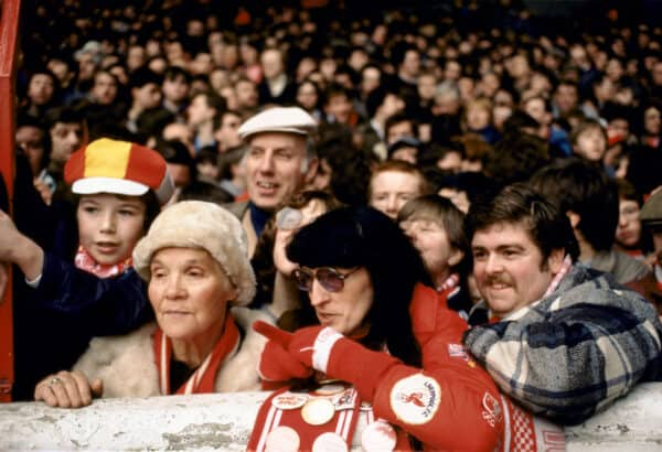 Family 1980s UK three generations Liverpool football fans Anfield Kop circa 1985. 80s HOMER SYKES. Image shot 1985. Exact date unknown.