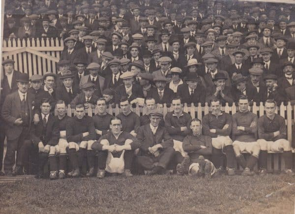 (Please credit within piece: The Bromilow family) The Liverpool squad, including manager David Ashworth, Elisha Scott, Tom Bromilow, Walter Wadsworth and Dick Forshaw sit in front of the Kop, 1920s