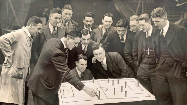 (Please credit within piece: The Bromilow family) Former Liverpool defender Tom Bromilow using a tactics board while manager of Burnley
