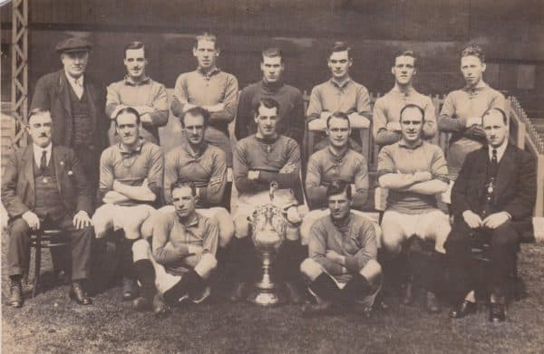 (Please credit within piece: The Bromilow family) Liverpool squad photo, including Jock McNab, Elisha Scott, Walter Wadsworth, Tom Bromilow, Dick Forshaw, manager David Ashworth, Ephraim Longworth and the First Division trophy, 1922