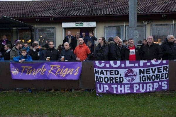 Spectators gather in front of the club house at the Delta Taxis Stadium, Bootle, Merseyside before City of Liverpool hosted Holker Old Boys in a North West Counties League division one match. Founded in 2015, and aiming to be the premier non-League club in Liverpool, City were admitted to the League at the start of the 2016-17 season and were using Bootle FC's ground for home matches. A 6-1 victory over their visitors took 'the Purps' to the top of the division, in a match watched by 483 spectators.