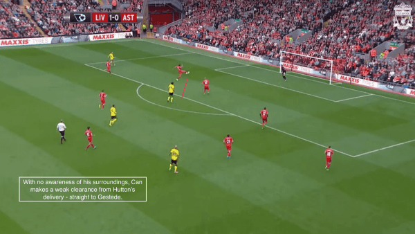 With no awareness of his surroundings, Can makes a weak clearance from Hutton's delivery - straight to Gestede.
