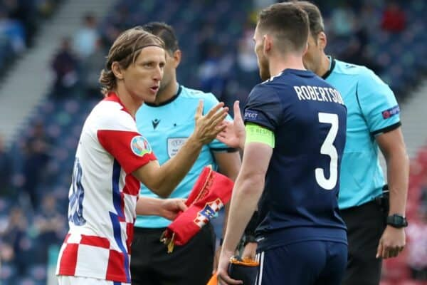 GLASGOW, SCOTLAND - JUNE 22: Luka Modric of Croatia interacts with Andrew Robertson of Scotland during the coin toss prior to the UEFA Euro 2020 Championship Group D match between Croatia and Scotland at Hampden Park on June 22, 2021 in Glasgow, Scotland. (Photo by Jan Kruger - UEFA/UEFA via Getty Images)