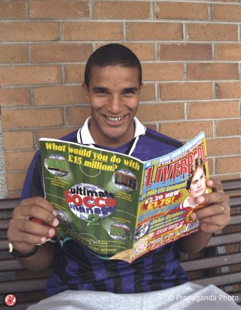Liverpool goalkeeper poses with a copy of the club's new official magazine at the club's Melwood Training Ground. (Pic by David Rawcliffe/Propaganda).