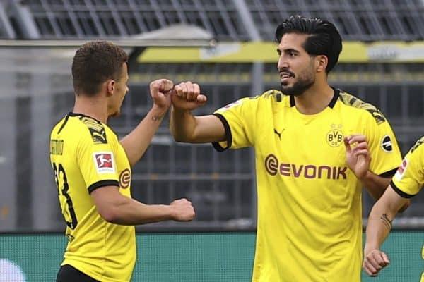 Emre Can of Borussia Dortmund cheers on his goal during the German Bundesliga soccer match between Borussia Dortmund and Hertha BSC Berlin in Dortmund , Germany, Saturday, June 6, 2020. (Lars Baron, Pool via AP)