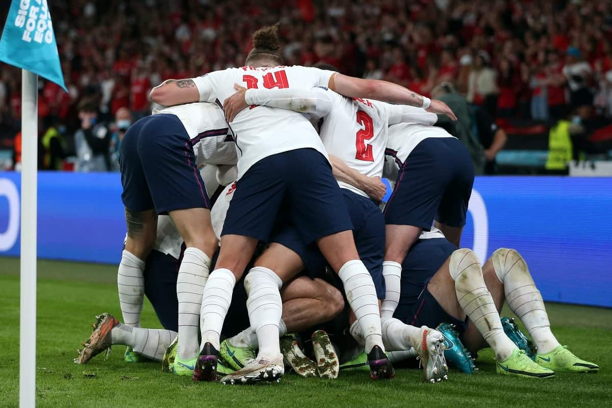 LONDON, ENGLAND - JULY 07: Harry Kane of England (obstructed) celebrates with teammates after scoring their team's second goal during the UEFA Euro 2020 Championship Semi-final match between England and Denmark at Wembley Stadium on July 07, 2021 in London, England. (Photo by Alex Morton - UEFA)