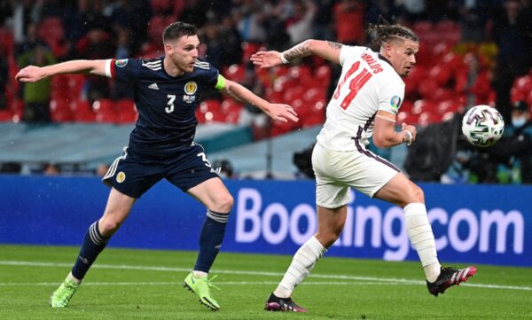 LONDON, ENGLAND - JUNE 18: Andrew Robertson of Scotland battles for possession with Kalvin Phillips of England during the UEFA Euro 2020 Championship Group D match between England and Scotland at Wembley Stadium on June 18, 2021 in London, England. (Photo by Shaun Botterill - UEFA/UEFA via Getty Images)