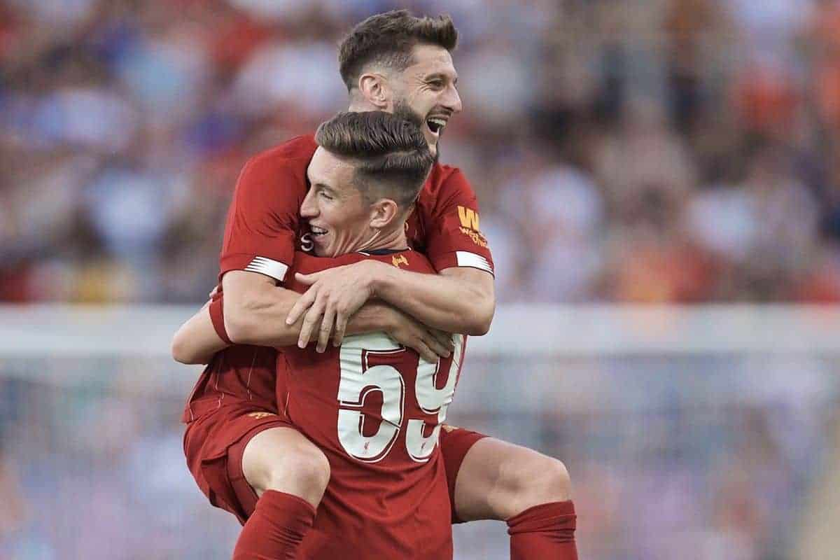 GENEVA, SWITZERLAND - Wednesday, July 31, 2019: Liverpool's Harry Wilson celebrates scoring the third goal with team-mate Adam Lallana (L) during a pre-season friendly match between Liverpool FC and Olympique Lyonnais at Stade de Genève. (Pic by David Rawcliffe/Propaganda)