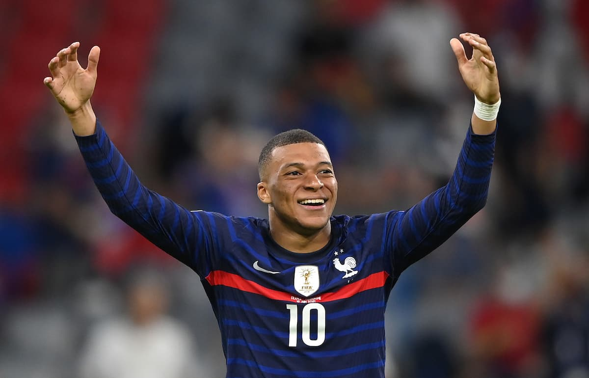 MUNICH, GERMANY - JUNE 15: Kylian Mbappe of France reacts after being challenged by Mats Hummels (Not pictured) of Germany during the UEFA Euro 2020 Championship Group F match between France and Germany at Football Arena Munich on June 15, 2021 in Munich, Germany. (Photo by Sebastian Widmann - UEFA/UEFA via Getty Images)