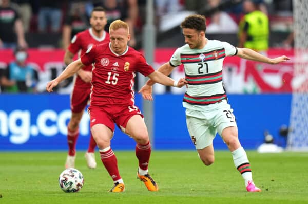 BUDAPEST, HUNGARY - JUNE 15: Laszlo Kleinheisler of Hungary is closed down by Diogo Jota of Portugal during the UEFA Euro 2020 Championship Group F match between Hungary and Portugal at Puskas Arena on June 15, 2021 in Budapest, Hungary. (Photo by Angel Martinez - UEFA/UEFA via Getty Images)