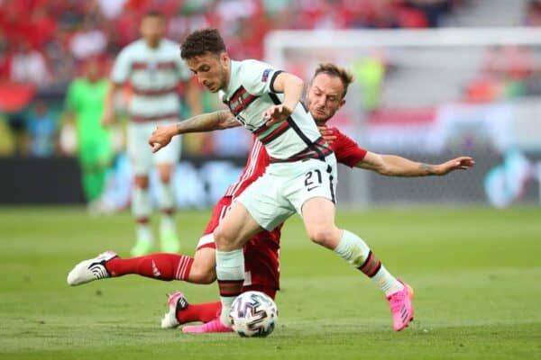 Diogo Jota of Portugal battles for possession with Gergo Lovrencsics of Hungary during the UEFA Euro 2020 Championship Group F match between Hungary and Portugal at Puskas Arena on June 15, 2021 in Budapest, Hungary. (Photo by Alex Livesey - UEFA/UEFA via Getty Images)