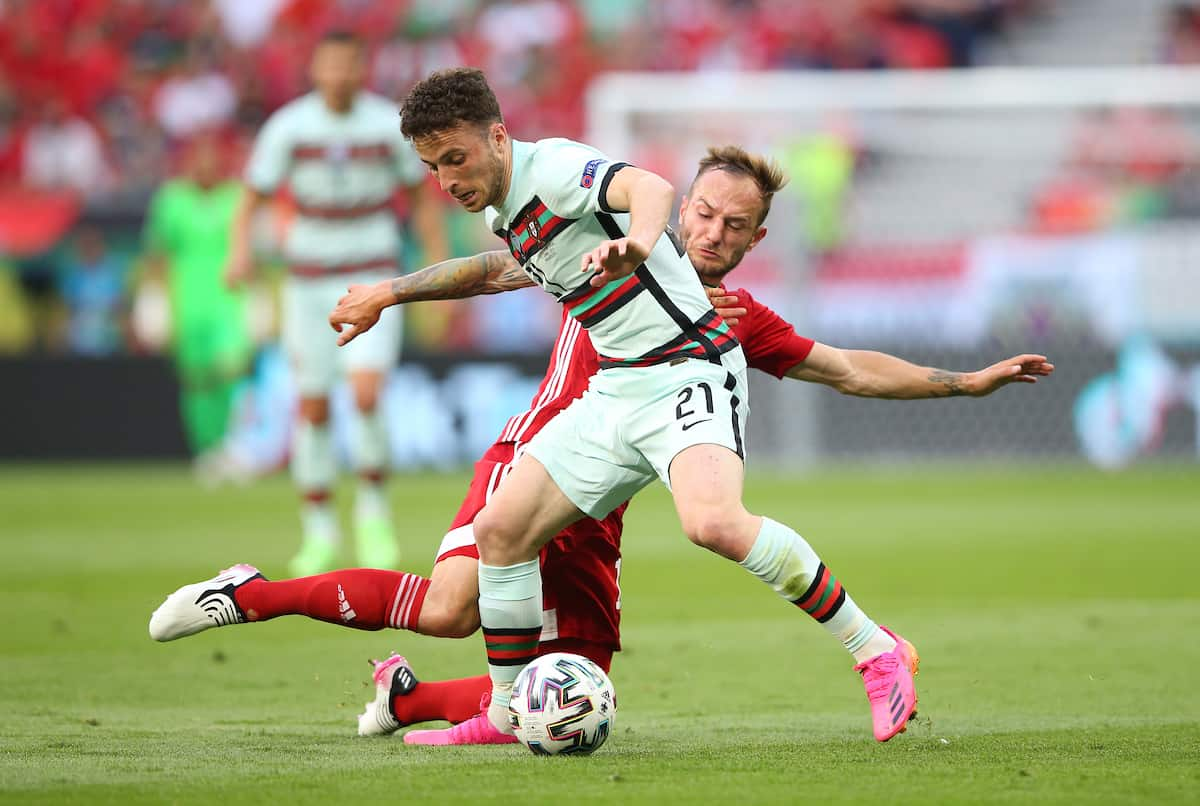 BUDAPEST, HUNGARY - JUNE 15: Diogo Jota of Portugal battles for possession with Gergo Lovrencsics of Hungary during the UEFA Euro 2020 Championship Group F match between Hungary and Portugal at Puskas Arena on June 15, 2021 in Budapest, Hungary. (Photo by Alex Livesey - UEFA/UEFA via Getty Images)