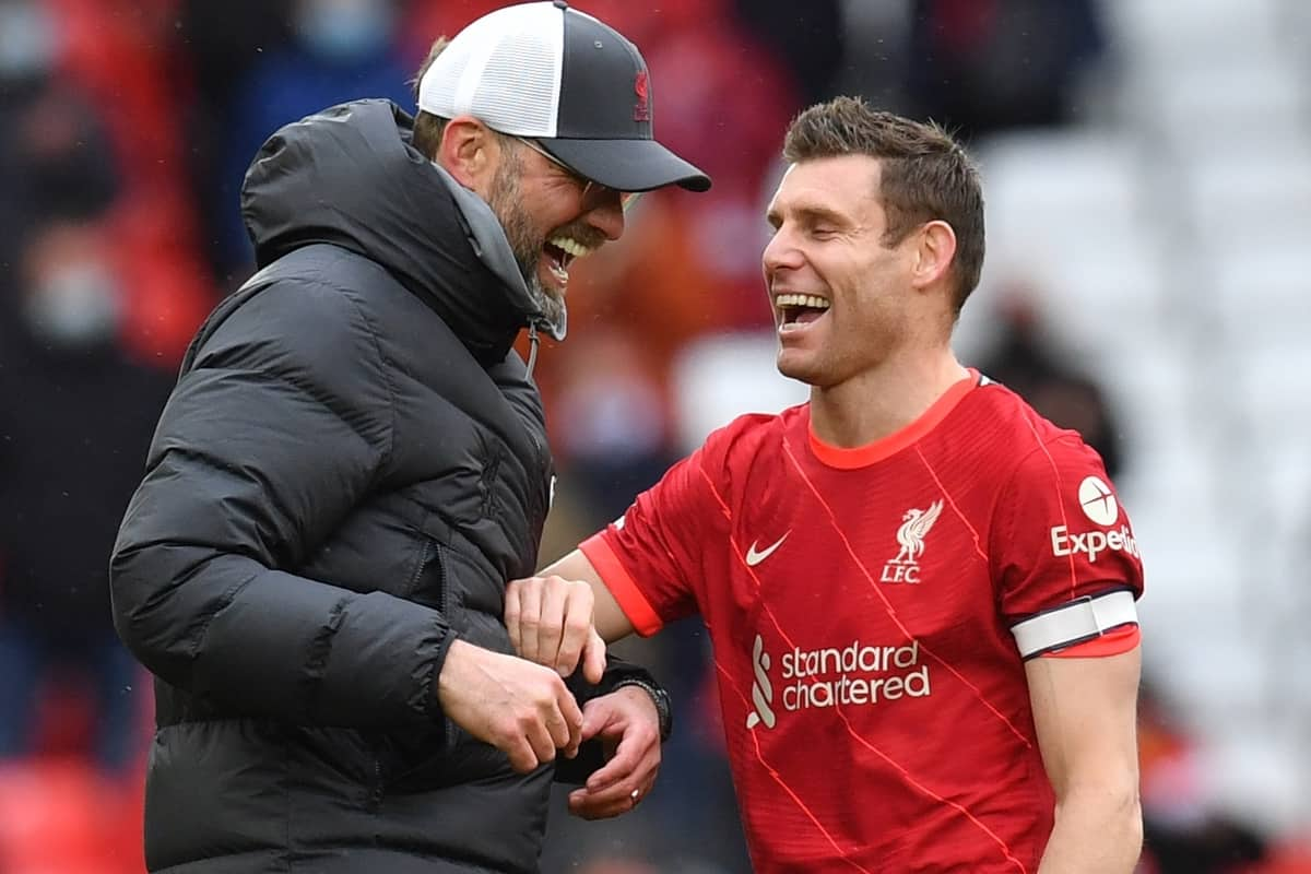 Liverpool's James Milner and manager Jurgen Klopp share a joke after the Premier League match at Anfield, Liverpool. Picture date: Sunday May 23, 2021.