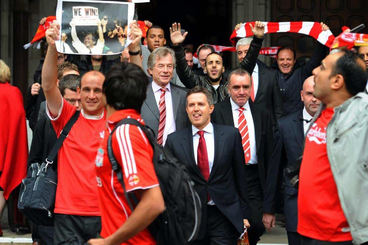 Martin Broughton, centre, managing director Christian Purslow, front centre, and Ian Ayre, right, pushed through the sale of Liverpool in 2010 after a High Court battle (Fiona Hanson/PA)