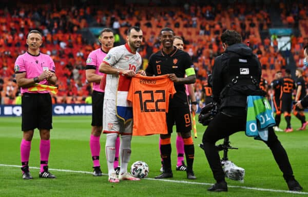 AMSTERDAM, NETHERLANDS - JUNE 21: Goran Pandev of North Macedonia receives a shirt from Georginio Wijnaldum of Netherlands prior to the UEFA Euro 2020 Championship Group C match between North Macedonia and The Netherlands at Johan Cruijff Arena on June 21, 2021 in Amsterdam, Netherlands. (Photo by Lukas Schulze - UEFA/UEFA via Getty Images)
