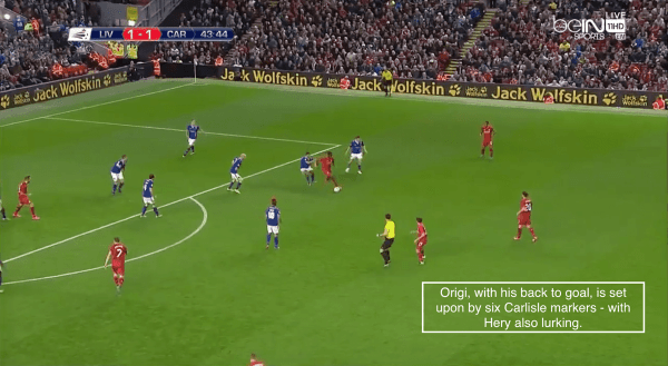 Origi, with his back to goal, is set upon by six Carlisle markers - with Hery also lurking.