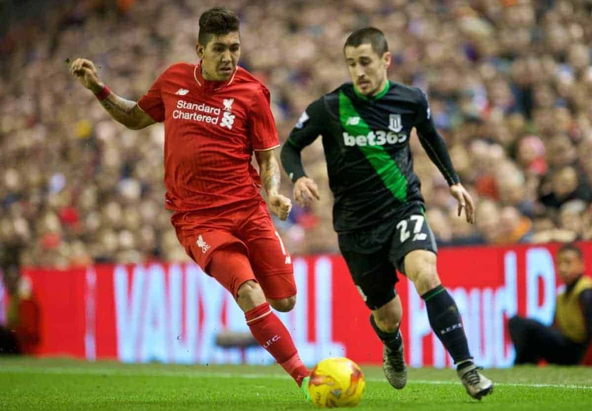 LIVERPOOL, ENGLAND - Monday, January 25, 2016: Liverpool's Roberto Firmino in action against Stoke City's Bojan Krkic during the Football League Cup Semi-Final 2nd Leg match at Anfield. (Pic by David Rawcliffe/Propaganda)