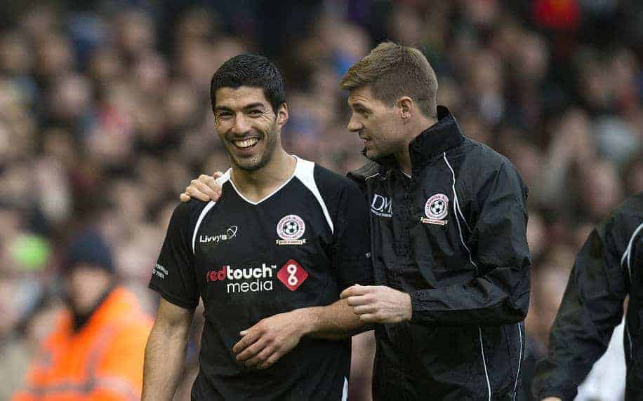 LIVERPOOL, ENGLAND - Sunday, March 29, 2015: Luis Suarez and Steven Gerrard share a joke at the end of the Liverpool All Star Charity match at Anfield. (Pic by Richard Martin-Roberts/Propaganda)