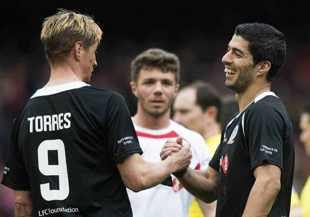 LIVERPOOL, ENGLAND - Sunday, March 29, 2015: Luis Suarez and Fernando Torres shake hands at the end of the Liverpool All Star Charity match at Anfield. (Pic by Richard Martin-Roberts/Propaganda)
