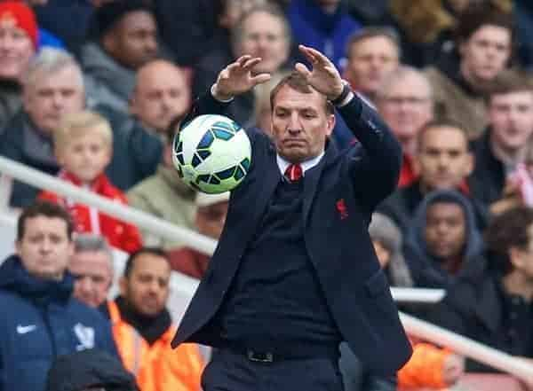 LONDON, ENGLAND - Saturday, April 4, 2015: Liverpool's manager Brendan Rodgers catches the ball the Premier League match against Arsenal at the Emirates Stadium. (Pic by David Rawcliffe/Propaganda)